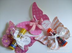 Lip balm butterflies, could also use candy rolls such as love hearts. from made2bcreative.com