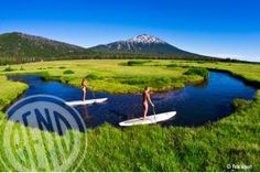 Stand Up Paddleboarding on Soda Creek | Did you know that Bend was recently named Outside Magazine's best SUP getaway in the world? If you didn't, you know now. Tons of rivers and lakes make Bend a water lover's dream town. | by Visit Bend/Pete Alport