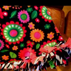 DIY Fleece blanket.. No sew this is like all other fleece blankets but when I tied the knots I added an extra piece of fabric. It made it really full around the sides and also added a little extra color!