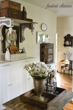 Love the salvaged corbels used as shelf brackets.