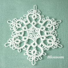 "Handmade Tatting Lace Christmas Ornament Snowflake by SnappyTatter, $12.50  ~shuttle tatted with the highest quality 100% Egyptian cotton cordonnet ~measures approximately 3-3.25"" ~Snappy Tatter snow is stiffened with a special clear fluid.  ~~~~~~~~~~~~~~~~~~~~~~~~~~~~~~~~~~~~~~~~~~~~~~~~~~~~~~~~~~~~~~~~~~~~~~~~~~~~~ This Snowflake has a limited availability as it is being discontinued as an available style."
