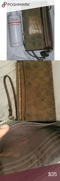 Coach Poppy Wristlet Its like 5 or 6 years old but, the inside is clean and there is 1/3 of the cleaner left. Coach Bags Clutches & Wristlets