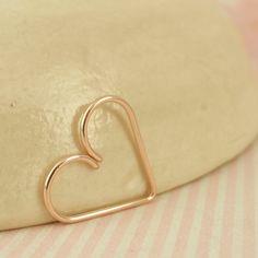 20 gauge14kt Rose Gold Filled Heart Piercing. $12.00, via Etsy.