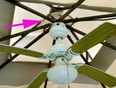 An electric ceiling fan in a canvas gazebo can keep you cool. A plastic pot liner helps protect the electrical parts.