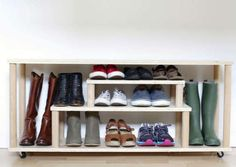 DIY a rolling shoe rack bench for your entryway. The great part about customizing is that you can create special spots for shoes and boots of varying heights.