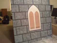 Gothic Walls. We tried canvas, plastic & other materials but the high winds tore them apart.  These use 1x1s to create a frame, plywood sheets (you could also use foam) are secured to the face.Using blue tape, mask out areas for windows, then paint with a dark brown/gray #Kingdom #Rock #VBS  #castle walls