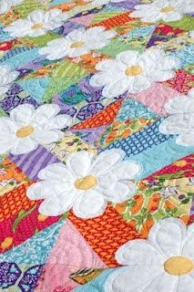 flower quilt…..daisies are raw edge appliquéd