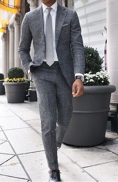 Simple Dark Grey or charcoal grey suit for men with elegant body fit white dress shirt & a smart watch. #menwithstyle