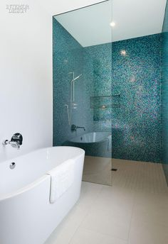 A Toronto home's shower stall from our simply amazing kitchen and bath roundup is clad in a scintillating mosaic of aquamarine glass tile sprinkled with magenta. Photography by Steve Tsai. Wet Rooms, Bad Inspiration, Bathroom Inspiration, Bathroom Renos, Small Bathroom, Bathroom Ideas, Mosaic Bathroom, Bathroom Designs, Bathroom Feature Wall Tile