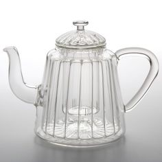 The Bonjour Teapots 31 oz. Insulated Oblong Ribbed Glass Teapot is worthy of use in a tea ceremony. Generously sized, it'll provide many cupfuls of hot tea. Plus, the insulated borosilicate glass keeps your tea hot for a longer period of time. The glass also resists shock and breakage, though hand-washing is recommended. Perfect for use with loose teas, its transparency makes it a lovely vessel to watch a flowering tea or blooming tea bundle unfurl before your eyes as it steeps.