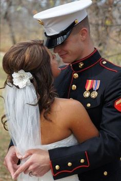Love this picture and the fact that the groom is making a heart with his hands behind her back