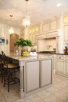 taupe/grey island with white/cream cabinets. love