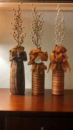 Fall wine bottles wrapped in ribbon