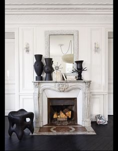 .Love the over sized white framed mirror- We could make these. Buy cheap flea market finds and spray paint them. Different ones in each room...