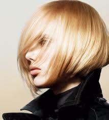 Cute blonde asymmetrical bob with long side swept bangs