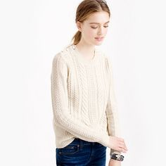 "We've been making cable sweaters for over 20 years. So when we say ""perfect,"" we're not messing around. This style also features chic shoulder buttons for a fun finishing touch. <ul><li>Semifitted.</li><li>Hits slightly below hip.</li><li>Lambswool.</li><li>Rib trim at neck, cuffs and hem.</li><li>Dry clean.</li><li>Import.</li></ul>"