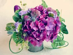 flowers and vegetable centerpieces in green and purple rustic containers www.labellumflowers.com