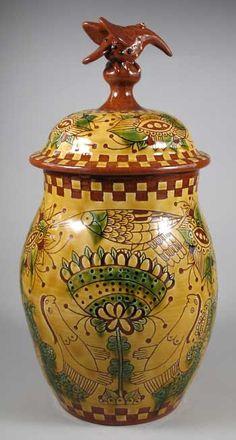 back of redware storage jar