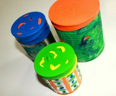 Tin Can Drums --- simply using some balloons! Paint them to make them pretty!