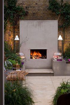 Urban fireside garden | This log-burning outdoor fireplace is the centrepiece of the garden | Charlotte Rowe Garden Design