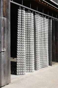 Betonvorhang consists of only two elements: concrete cushions are attached to…