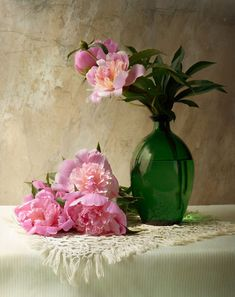 """Jolanta Brigere """"Peonies"""" photo The pink to purple of the flowers and the deep green bottle against the white doilie and table cloth...all with that beautiful rough hewn brownish wall"""