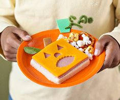 Carve a little fun into snack time. Open-face bologna-and-cheese sandwiches are easier to carve than a pumpkin. Use small cookie cutters to cut jack-o'-lantern features into cheese slices. Remove crusts from bread slices, and trim bologna slices to fit the bread. Layer the cheese face on top, and complete the pumpkin with a bread-crust stem and basil leaf./