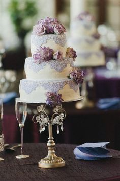 Wedding cake with purple lace detailing //  Image by http://www.avantimages.net, See more: I adore this design with lace decor. http://theeverylastdetail.com/romantic-purple-wedding/