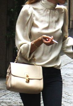 White leather bag and white silk top casual style