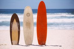 surfboards in sand - lined up