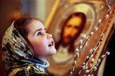 How beautiful. <3 I love that there is an icon of the Holy Face behind her, and I do wonder what she is looking at! Unless we become like little children...