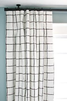An open check or window pane fabric in black and white with some grey shading. Suitable for drapes, roman blinds, decorative pillows, cushions, shower curtains