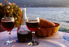 A typical start to dinner in a Greek restaurant - a paper tablecloth, a carafe of inexpensive red wine, a load of bread, and a view of the sea. Paper Tablecloth, Greek Restaurants, Samos, Carafe, Red Wine, Alcoholic Drinks, London, Dinner, Glass
