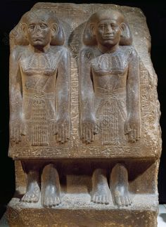 Sehetepebreankh-nedjem and his son, high priests of Ptah, sandstone sculptural group dating from the reign of Sesostris III. Egyptian civilisation, Middle Kingdom, Dynasty XII. Paris, Musée Du Louvre