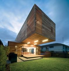 Sophisticated Unique Shaped House: Trojan House : Modern House Design Suspended Architecture With Ceiling Lamp