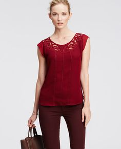I love the color of this top and the embellishments.  Put it on with a nice pair of slacks and go.  Embellished lace and cutout trim invite a closer look, as shown by this gorgeous georgette must-have. Jewel neck. Front keyhole with button closure. Picot edged cap sleeves.