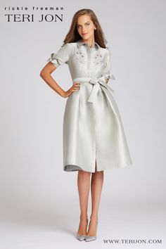 This is a classic shirt dress, but way more glamorous. The embroidered cut out, short sleeves, and bow at the waist makes this tea length dress perfect for rehearsal dinners, backyard weddings, and engagement parties. Tea Length Skirt, Tea Length Dresses, Gowns With Sleeves, Short Sleeves, Long Sleeve, Printed Gowns, Sequin Gown, Jacquard Dress, Stretch Satin