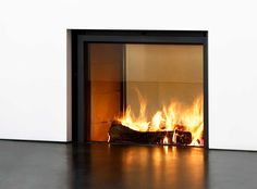 | FIREPLACE | #StuvFireplace - 2 sided #woodburning insert. Gone are the traditional trims for fireplace inserts. A much more sophisticated way to bring fire into the home.