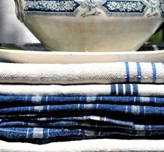 Blue and white linens and blue transferware.