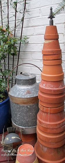 ELEMENT;stacked clay pots form a terra cotta tree