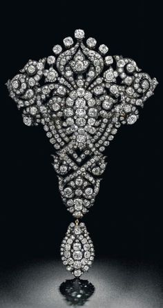 Maria Christina Royal Devant-de-Corsage brooch (est. $1.5 – 2 million), a magnificent diamond brooch given as a wedding present by King Alfonso XII of Spain to his wife the Archduchess Maria Christina of Austria in 1879.
