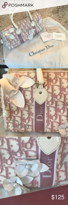 Dior Purse Authentic Christian Dior Purse! White background with light pink writing. It has white flowers and butterfly with pearls and rhinestones in ok used condition. It does have some stains and signs of wear and is also missing a locket that was on the zipper (it had no function just for looks) if you would like any additional photos please ask! Bags