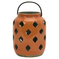 Moroccan-inspired ceramic lantern with diamond cutouts.Product:  Lantern  Construction Material: Clay  Color: Multi Accommodates:  (1) Candle - not included    Dimensions: Small: 8 H x 6.5 DiameterMedium: 11.75 H x 6.5 DiameterLarge: 15 H x 6 Diameter
