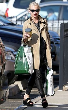 Wayfarers go with just about any look! Check out on-the-go gal Michelle Williams rocking this style with a sleek trench coat while running errands!