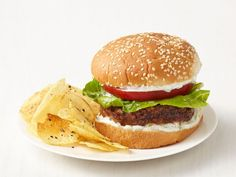 In lieu of ketchup and mustard, whip up an easy yogurt sauce for a new take on Mediterranean Turkey Burgers.