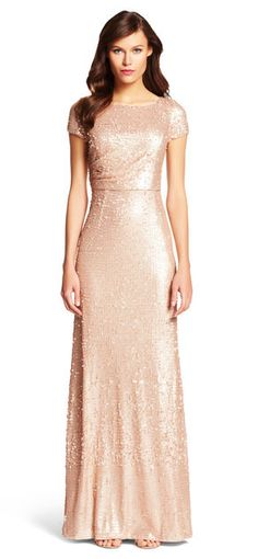 Rows of shimmering sequins cover this floor-grazing gown, featuring a fitted and alluring silhouette.