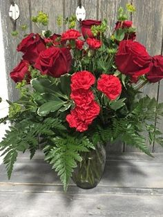 A twist on the traditional dozen roses, large imported roses, accented with filler flowers, and lush tropical foliages. Dozen Roses, Lush, Beautiful Flowers, Hot Pink, Happy Birthday, Tropical, Valentines, Gardening, Seasons