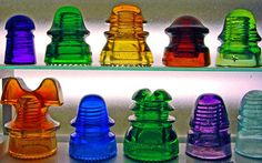 glass telephone pole insulators - if i thought those things were still up there i am afraid my glass fetish would have me braving the hazards of high places and electricity to grab some of these beautiful little glass creations...i love the chemistry behind getting these colors into glass! beautiful and fascinating!!!