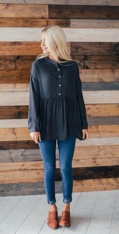 With a great combo of fit and flair this top will be perfect for your fall wardrobe. Available in great new fall colors! You will love wearing this to the pumpkin patch, the grocery store or date night!