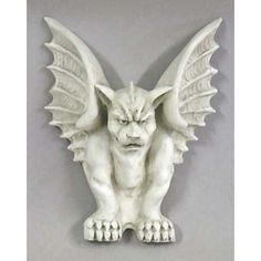 Gargoyle Wall Plaque.Made of durable fiberglass and designed for outdoor use year-round. A great piece to hang over a doorway. Several finish options available for this protector gargoyle